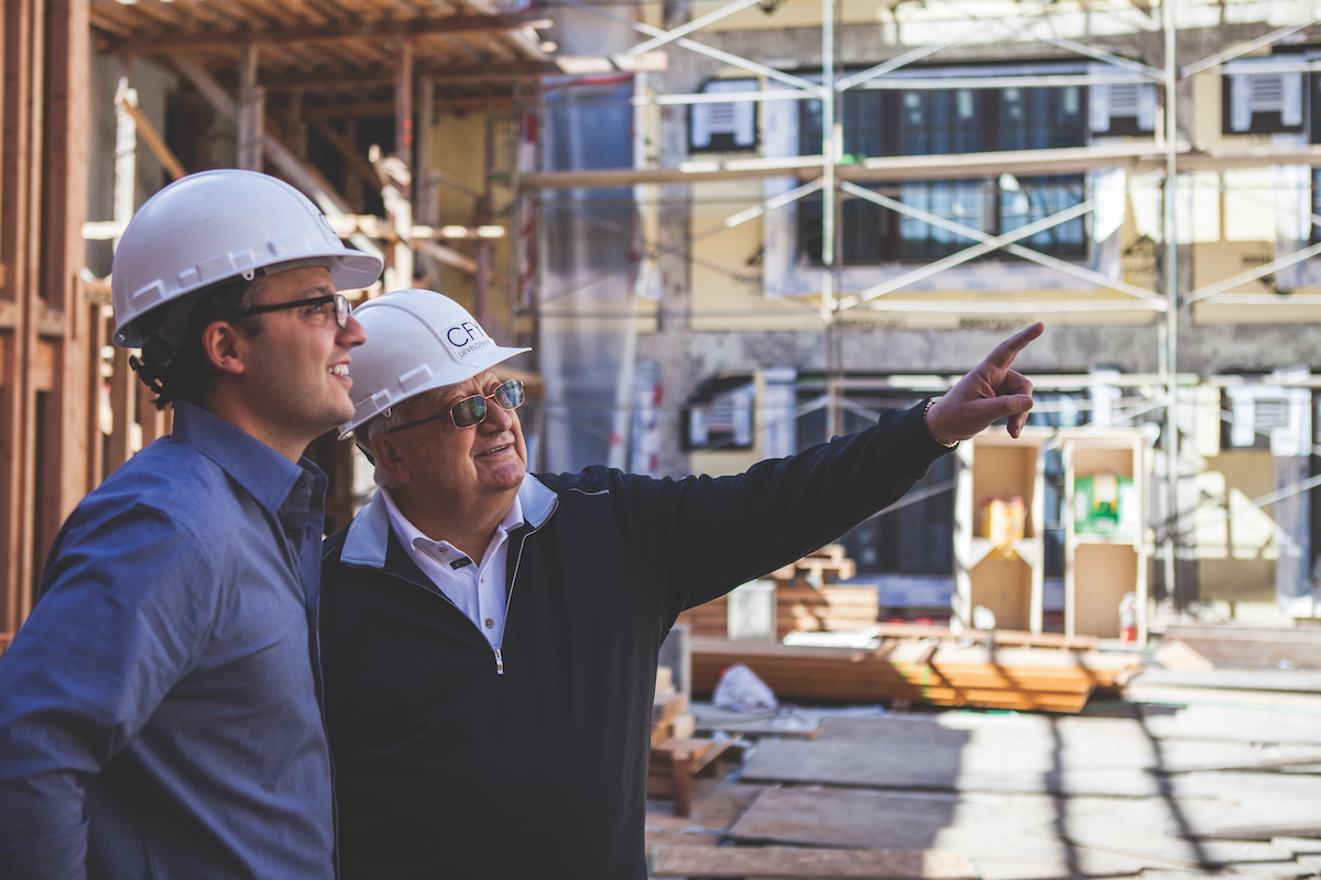 The late Ali Youssefi (left) with his father and WAL co-developer Cyrus Youssefi during the project's construction phase in February 2014 (Photo by Nicholas Wray courtesy of CFY Development)