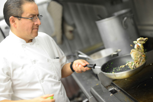 Chef-owner Ramiro Alarcón gets cooking in the kitchen.