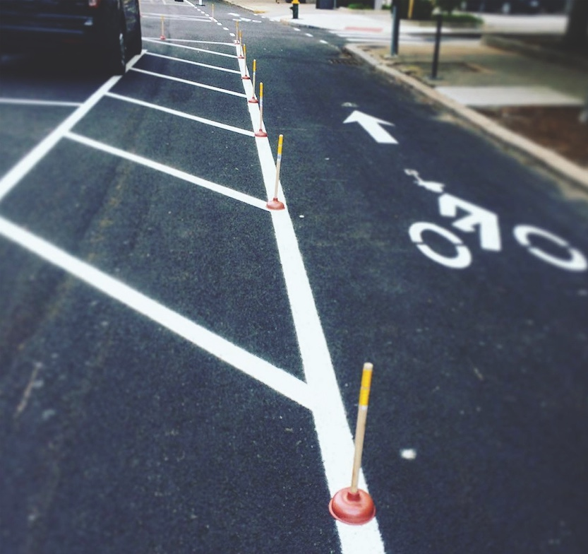 In May, a cyclist in Providence, Rhode Island, created a protected bike lane using 72 plungers. (Photo by Anthony Puliafico Jr.)