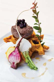 St. Orres Restaurant's venison with wild huckleberries and yam waffles