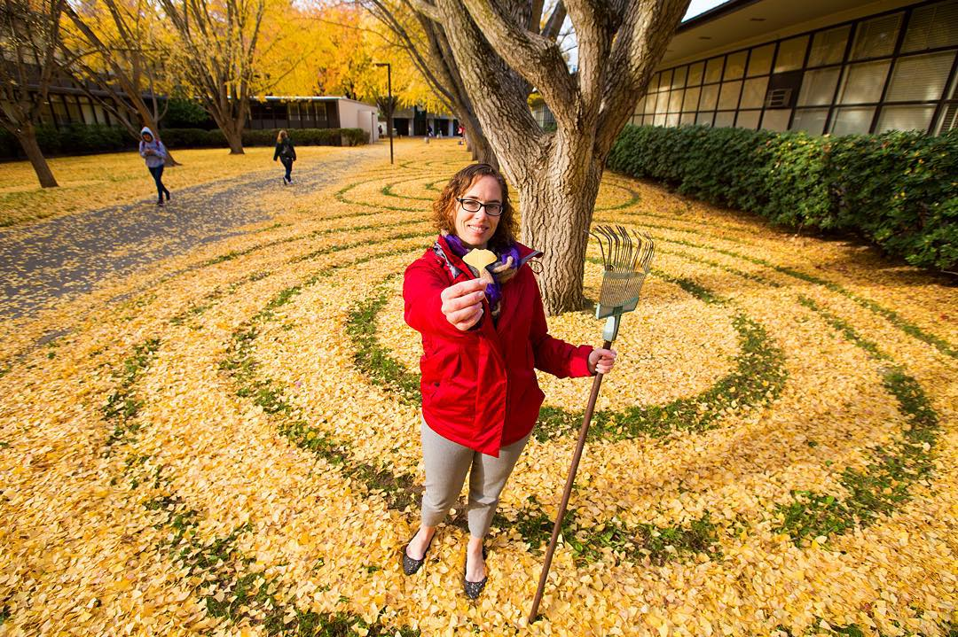 Joanna Hedrick poses with her gingko leaf art at Sacramento State University in December 2015. (Photo by Jessica Vernone)