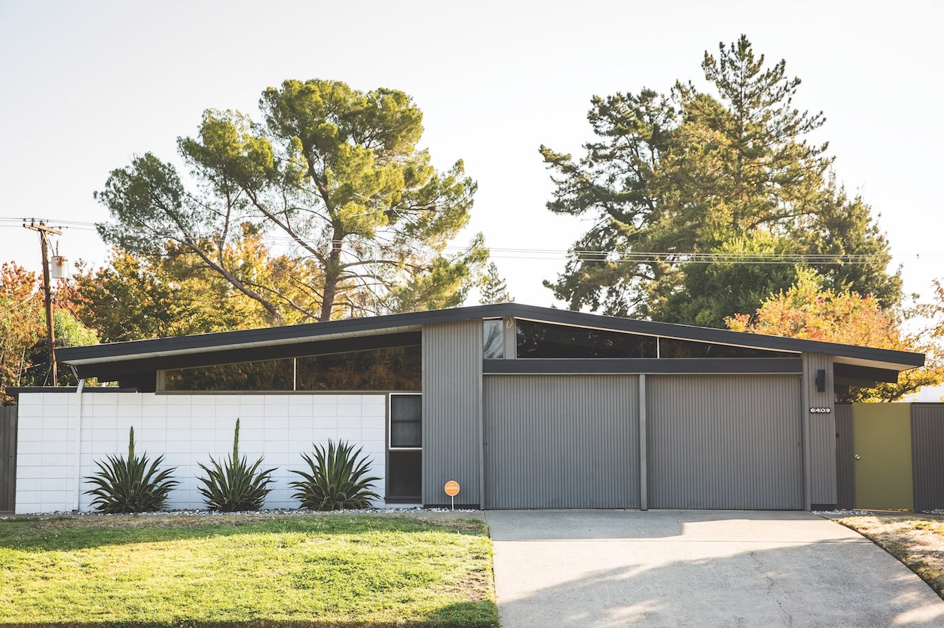 Eichler homes, like this one in South Land Park Hills, are known for their low-sloping roofs and few windows facing the street. (Photo by Max Whittaker)