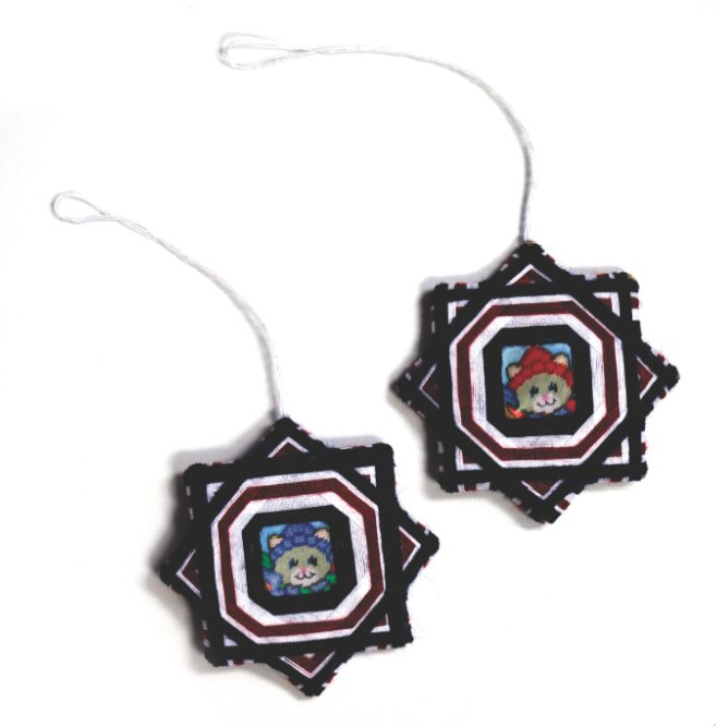 A pair of Christmas ornaments made by Puente in prison