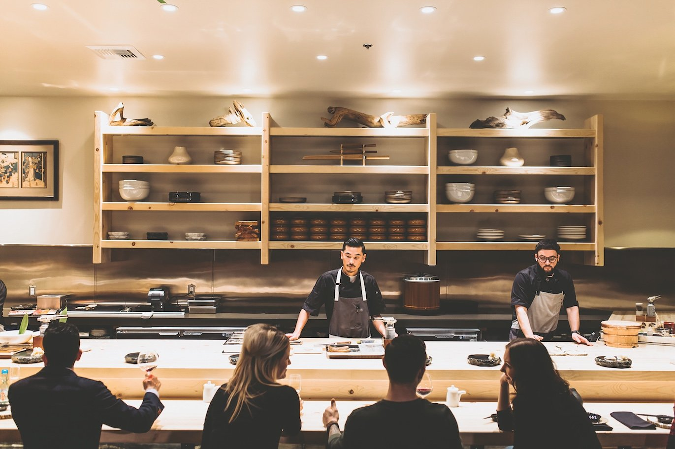 "Kru's all-maple sushi bar, countertops and shelves create a dramatic yet uniform look. ""You see this type of wood in a lot of high-end sushi bars in Japan,"" says Johnson. ""I wanted something that was very clean and streamlined. I just thought it was really pretty."" (Photo by Black Field Media)"