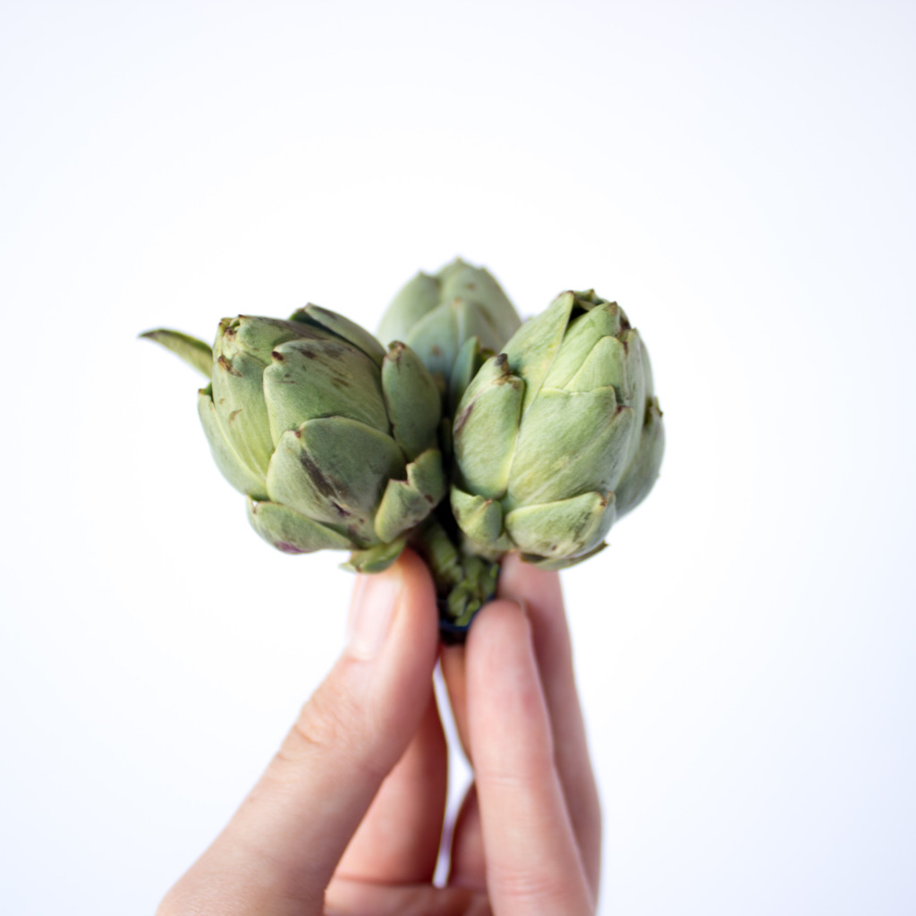 tiny artichokes in hand