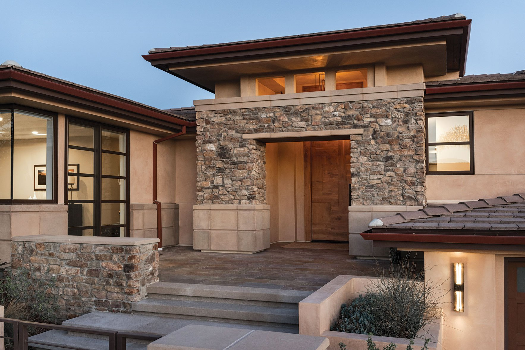 La Jolla coastal family-friendly remodel front entryway with stone and custom door