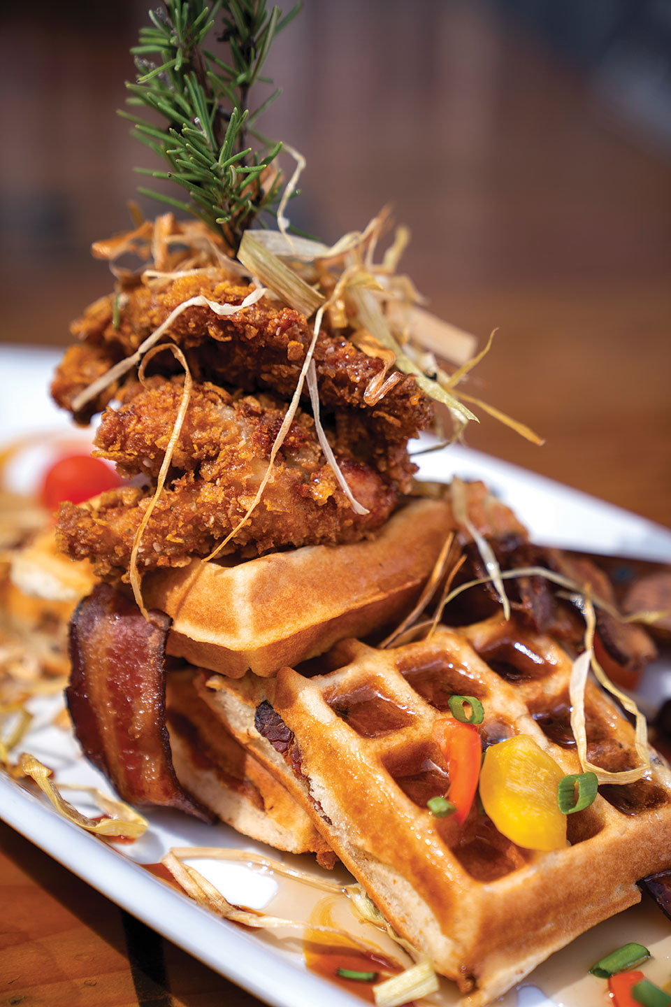 The big o' sage friend chicken and waffle tower at San Diego's Hash House A Go Go