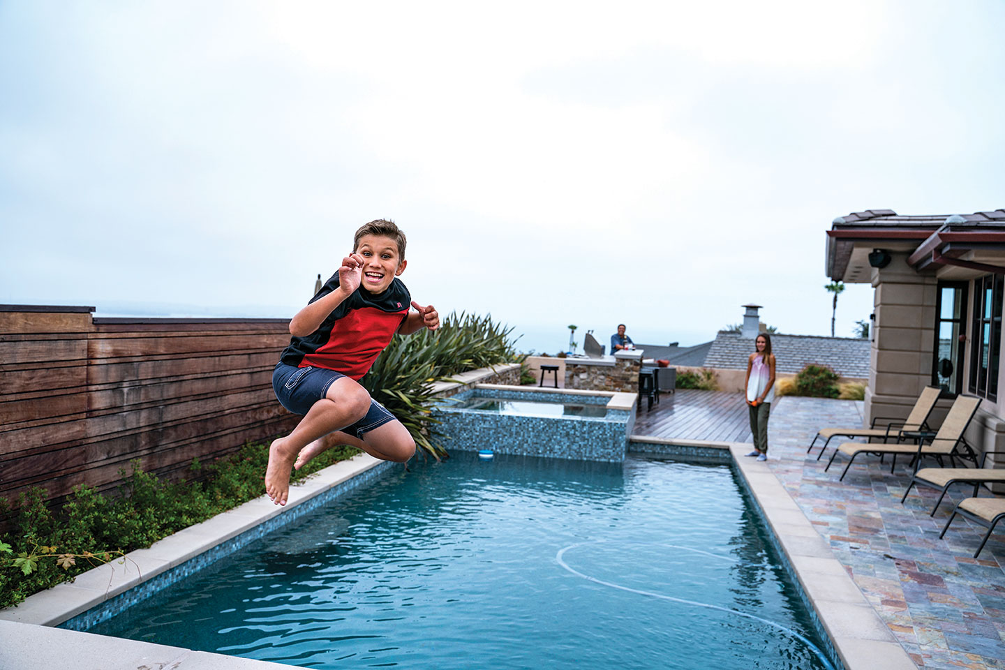 Coastal family-friendly remodel pool with kids