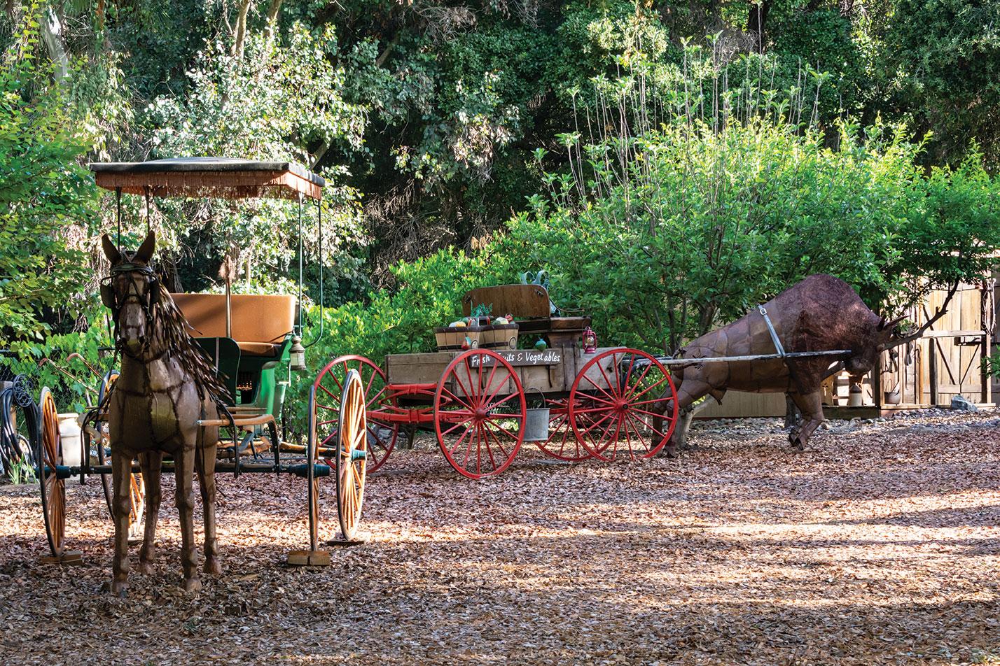 garden motif western wild west mexican sculpture horse buffalo wagon