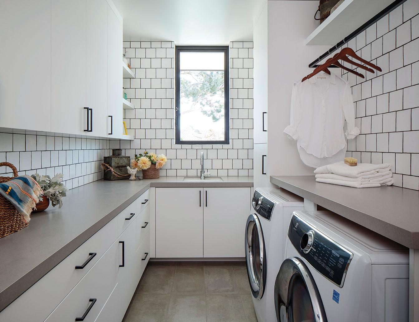 laundry room white tile neutral color design san diego
