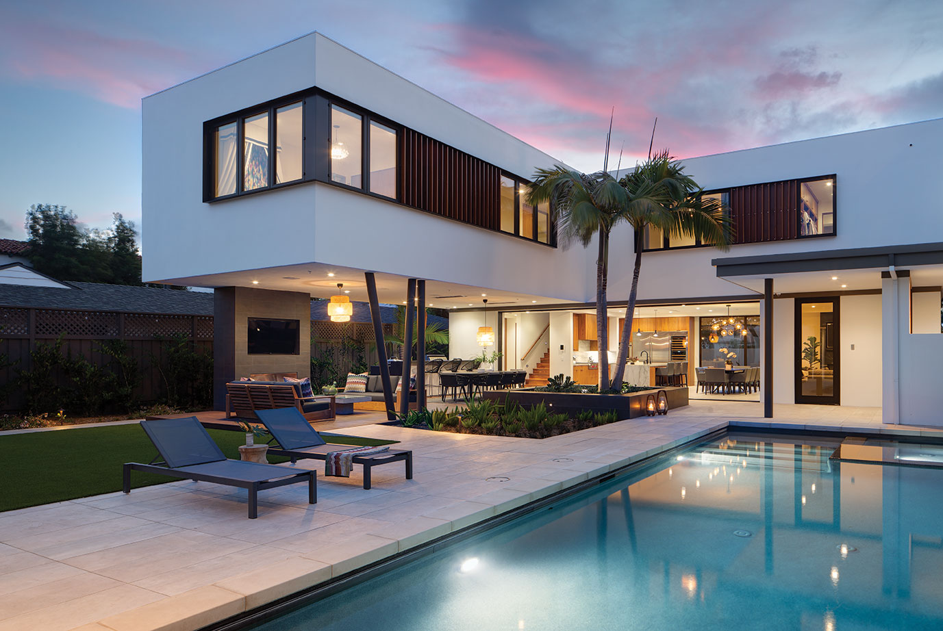 cantilevered architecture modern family home pool at sunset