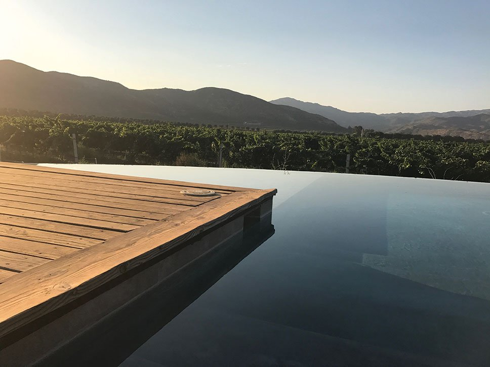 Bruma pool deck vineyard views valle de guadalupe mexico travel