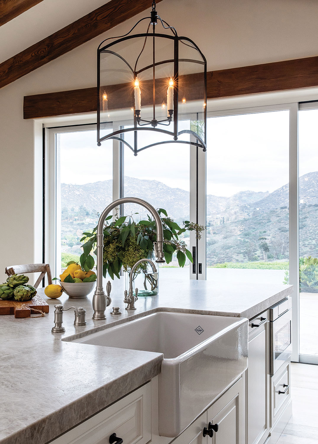 views of mt woodson in poway through full wall glass doors in a san diego kitchen