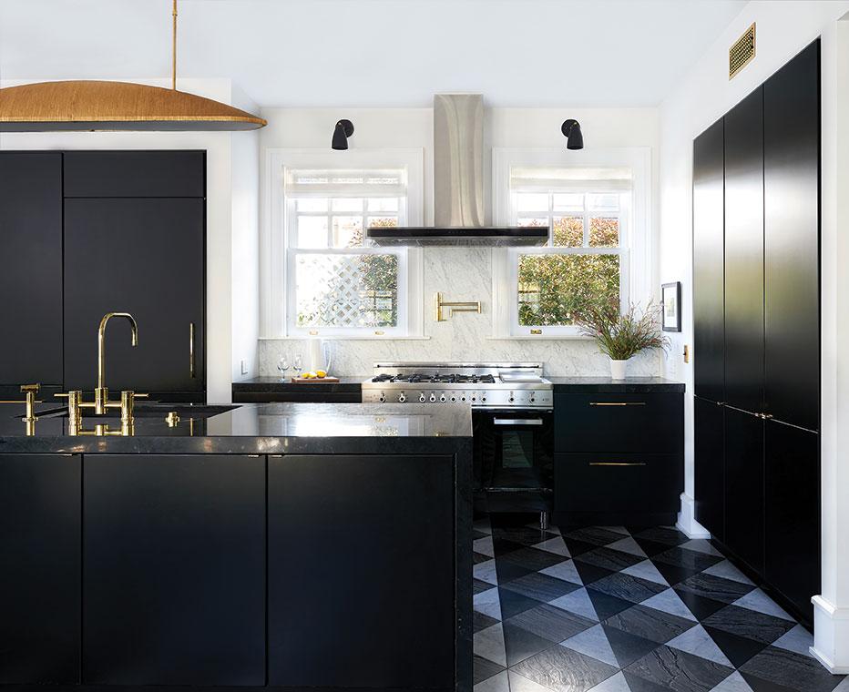 black kitchen bronze brass faucet marble backsplash