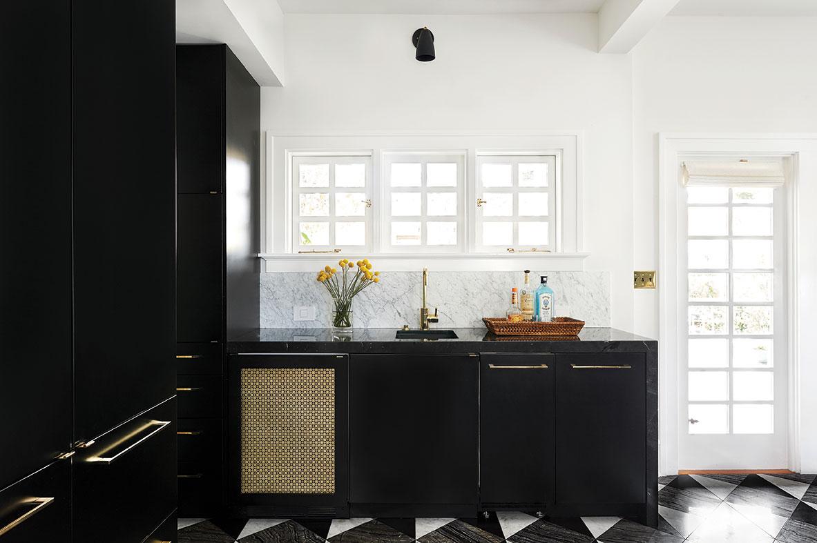 black kitchen brass accents marble