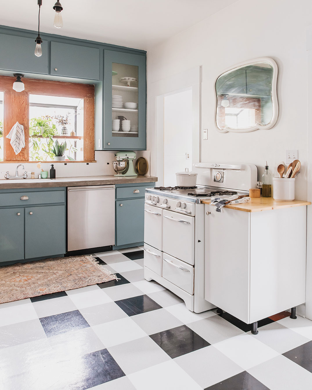 DIY kitchen changes retro peel and stick flooring black and white with a vintage stove