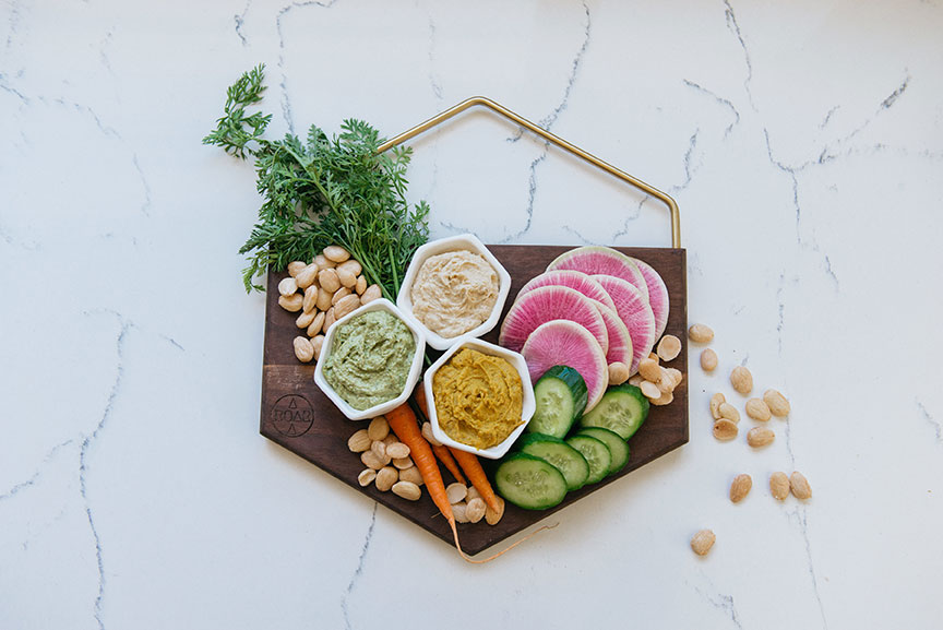 aroara industries artisan cutting board by san diego local maker elena skidmore with sliced veggies and hummus