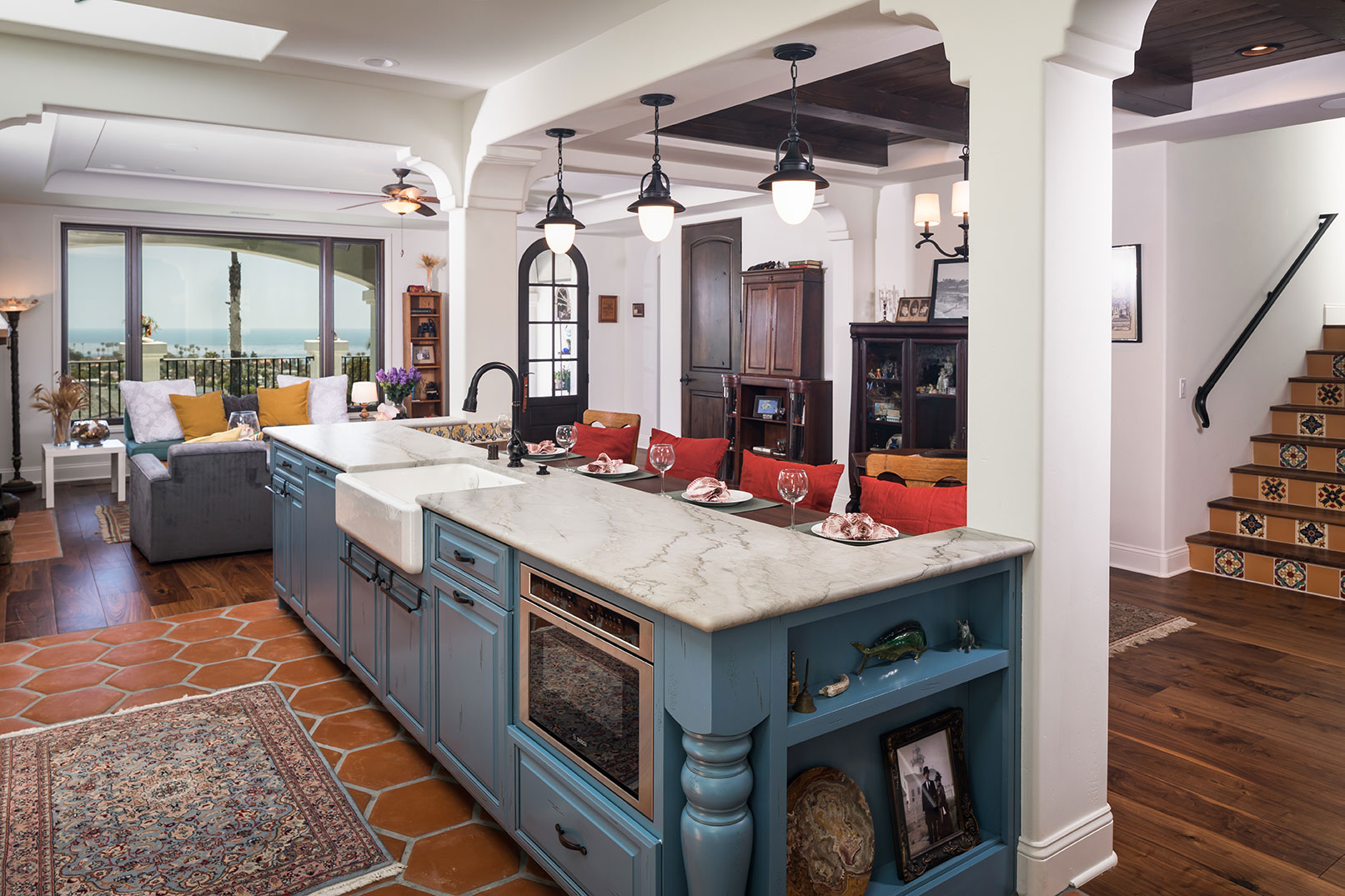 ocean view living area in ocean beach san diego with blue kitchen cabinetry and retro tiles