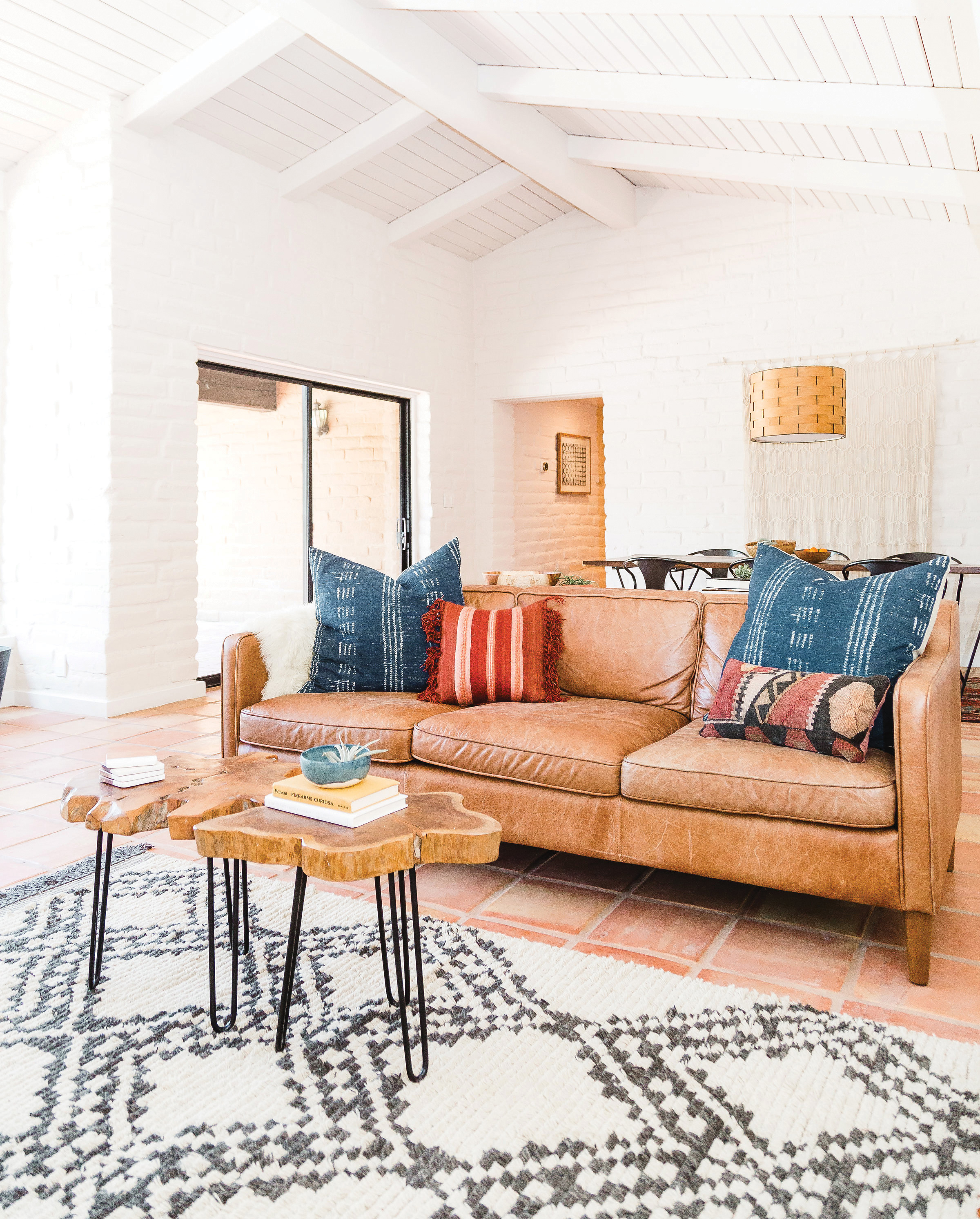 southwestern style desert style brown leather couch white walls black and white