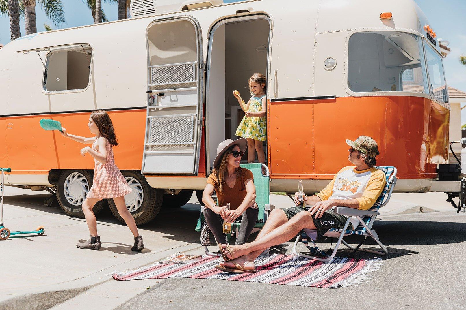 vintage Argosy trailer remodel orange and white nomadic family life
