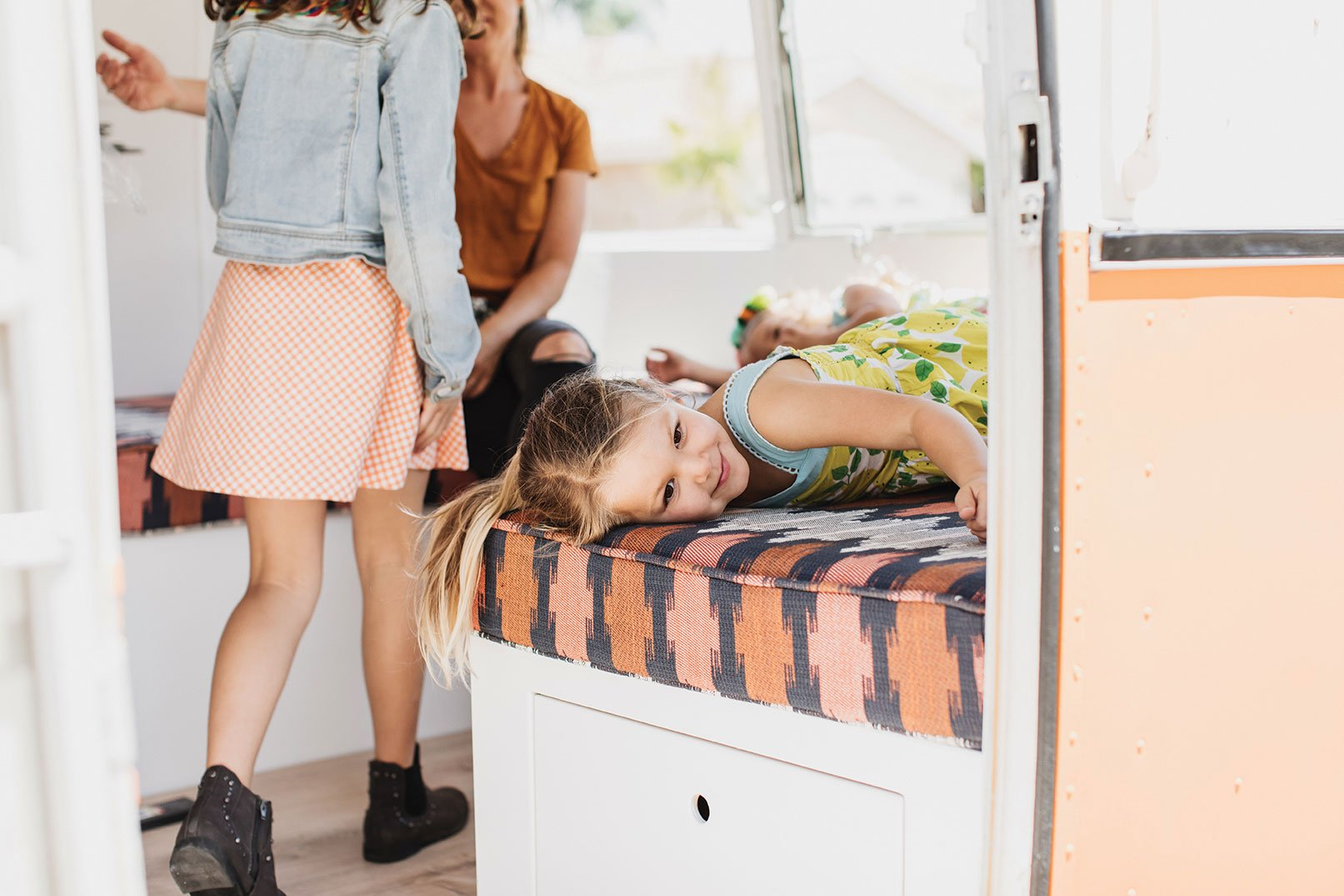 vintage Argosy trailer remodel with kids bench made of ikat fabric