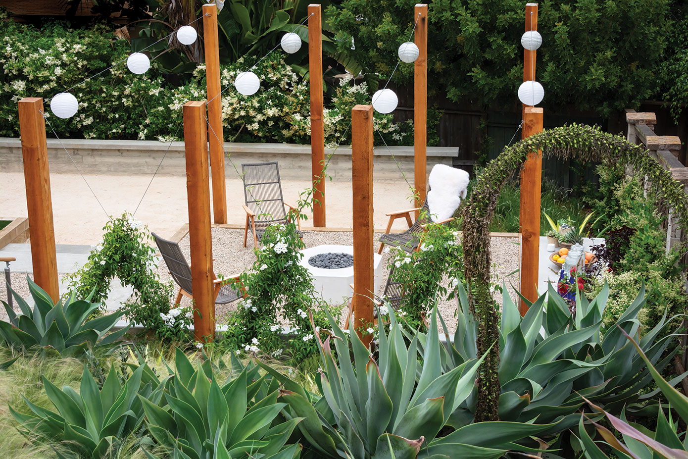 wooden posts and vines outdoor fire pit