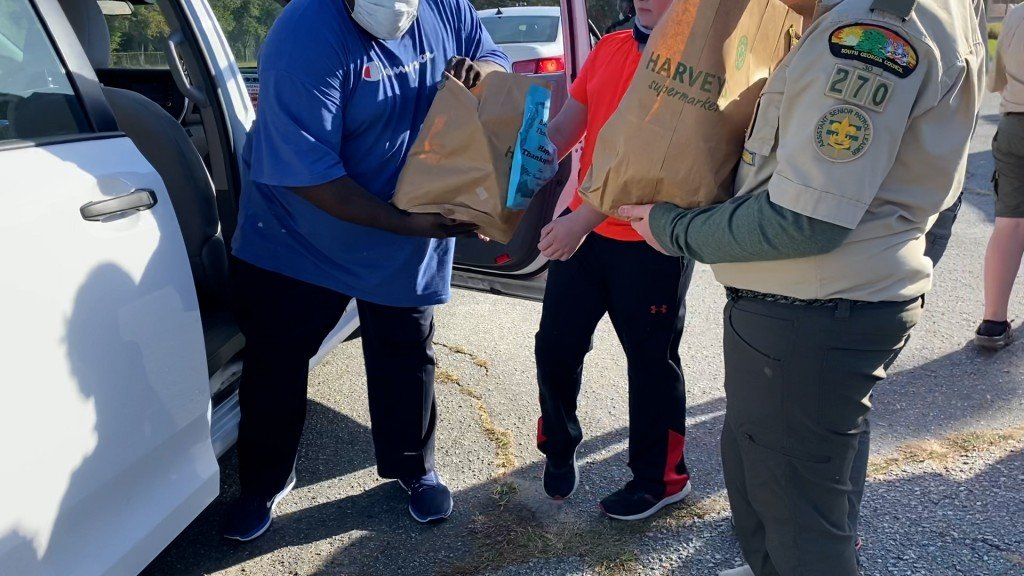 Boy Scouts Giving Food