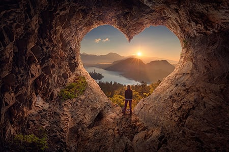 Woman Looking Out Through Heartshaped Rock Arch 89712979 M 450