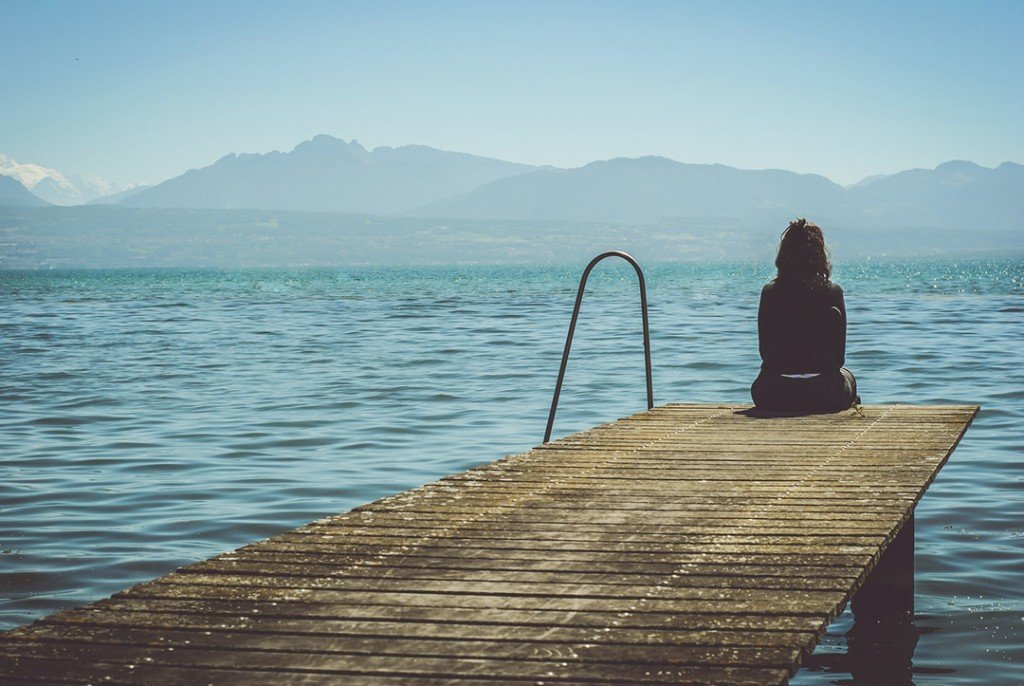 Woman On A Dock Meditating Photo 1476782916354 326ab24c93df Slider