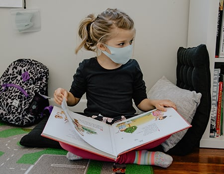 Young Girl Reading A Book With A Mask Kelly Sikkema R2htbxekgwq Unsplash