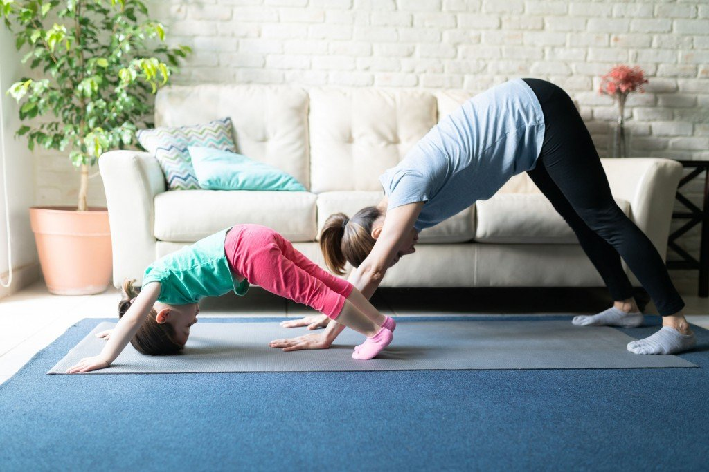 Family Doing Yoga Together At Home