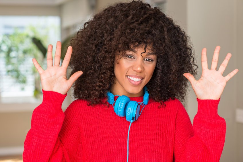 African American Woman Wearing Headphones Showing And Pointing Up With Fingers Number Ten While Smiling Confident And Happy.