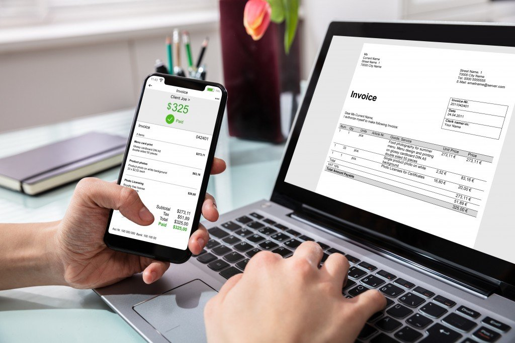 Businessperson Paying Invoice On Mobilephone
