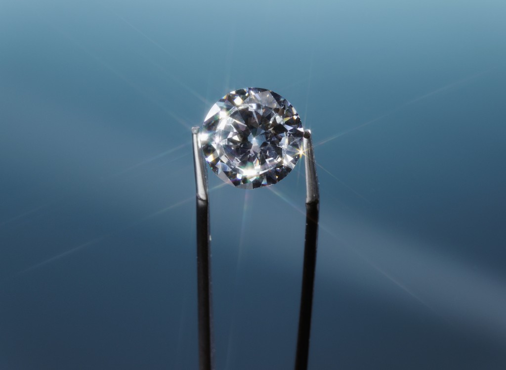 Tweezers Holding Diamond, Close Up