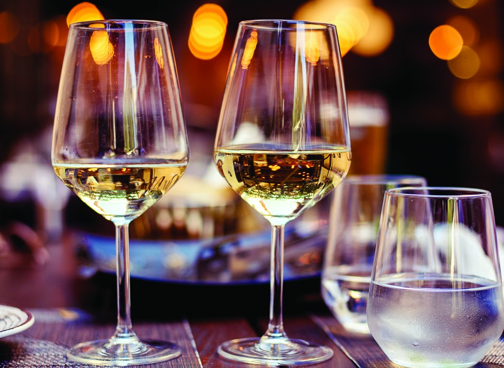 Two Glasses With White Wine In A Restaurant