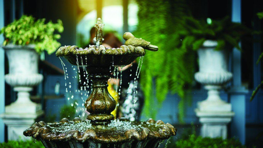 Multi Storey Fountain In The Garden Standing In Front Of A Shop