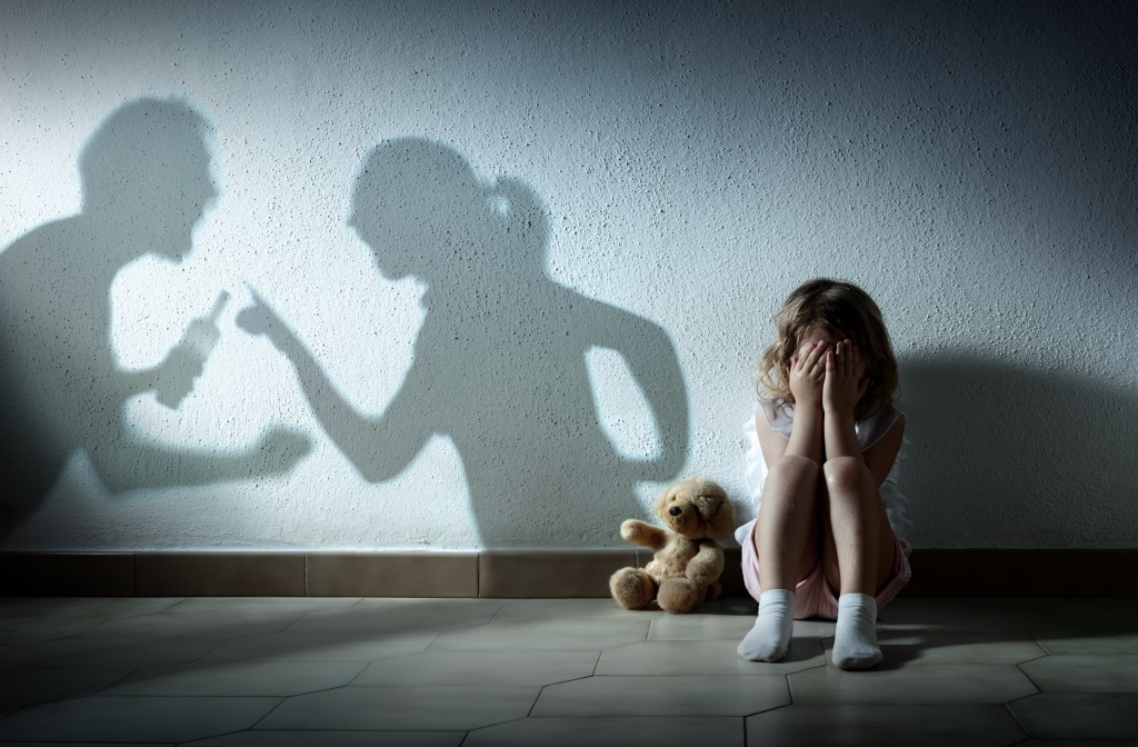 Little Girl Crying With Shadow Of Parents Arguing Home Violence And Divorce