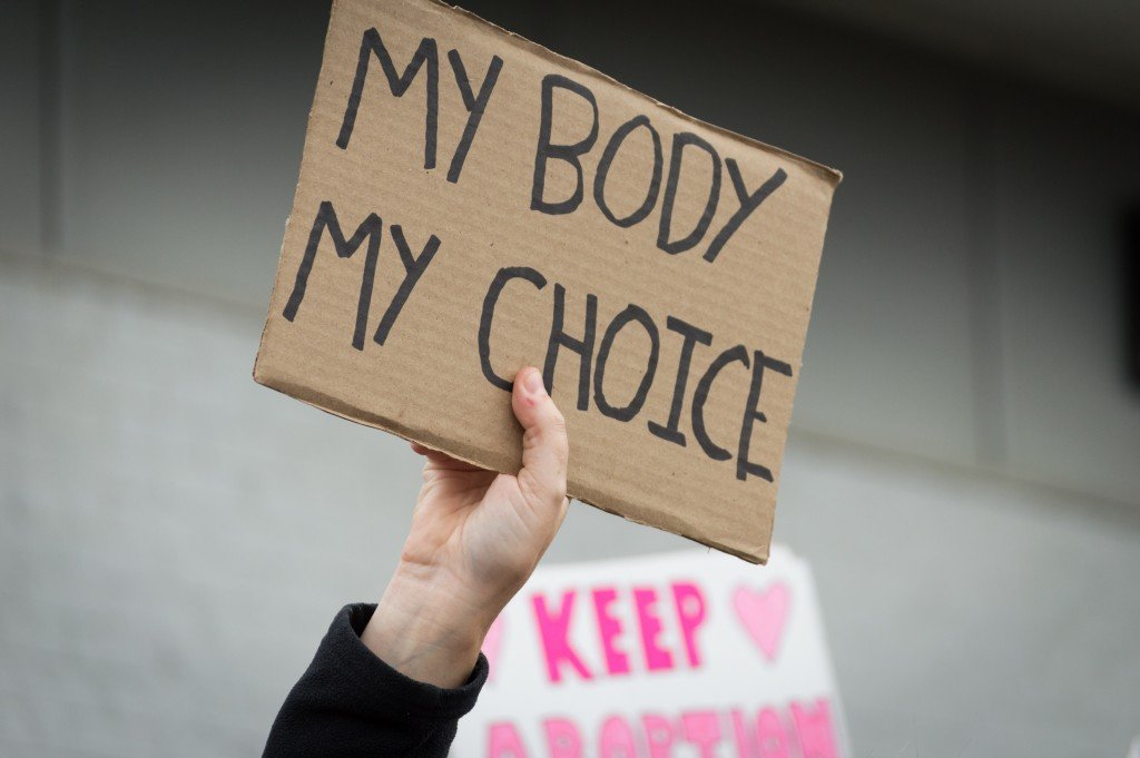 Pro Choice Planned Parenthood Demonstration Holding A Sign