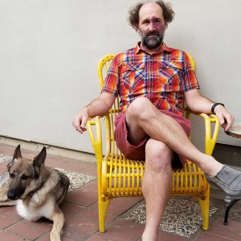 Press Photo Sitting With Dog V3 Photo By Amy Bee