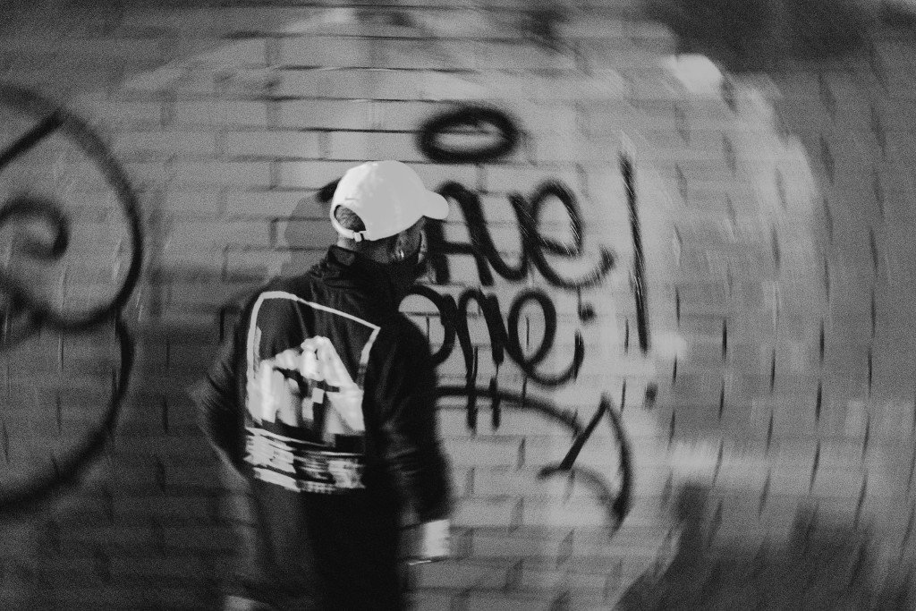 Dave One putting his tag on a wall