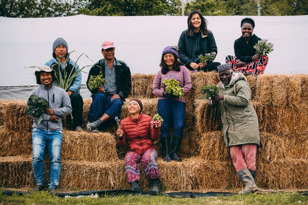 A group photo of some farmers in the New Roots for Refugees program