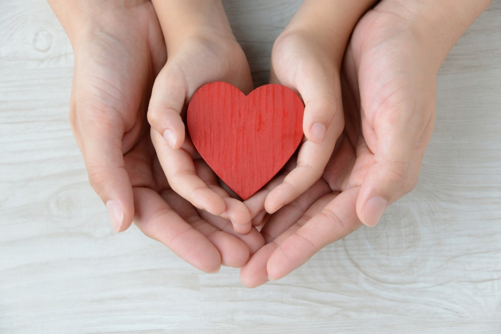 Heart Object Covered By Mother And Child's Hands