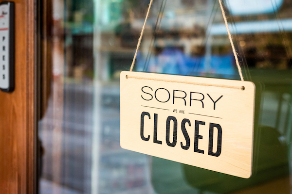 Sorry We Are Closed Sign Board Hanging On Door Of Cafe