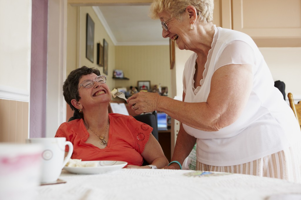 Carer Helping Woman Eat