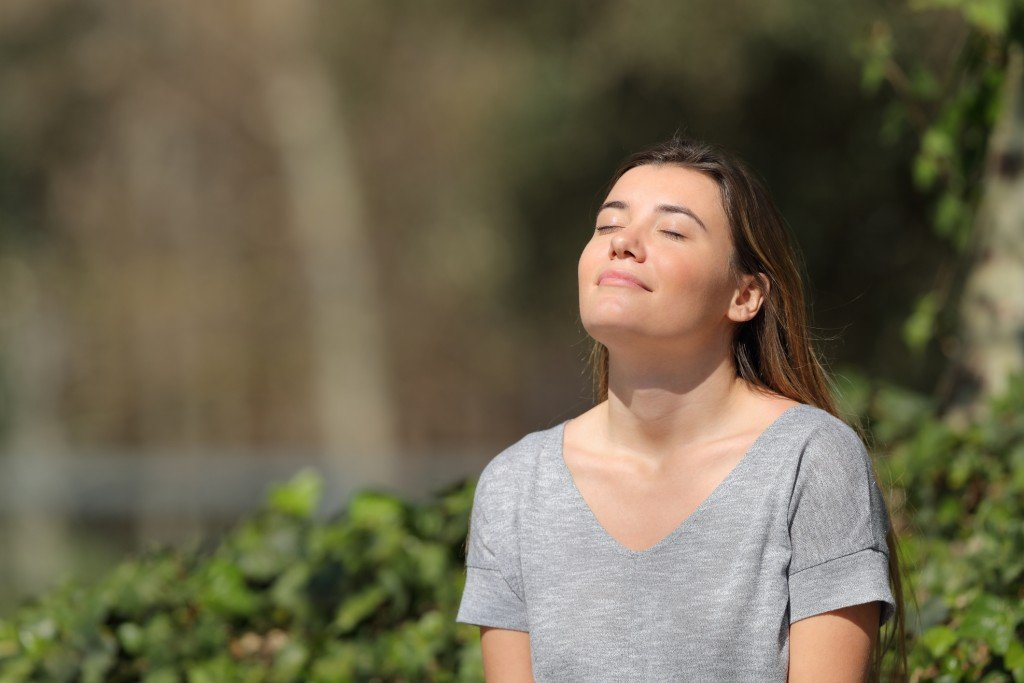Relaxed Girl Breathing Fresh Air In A Park A Sunny Day