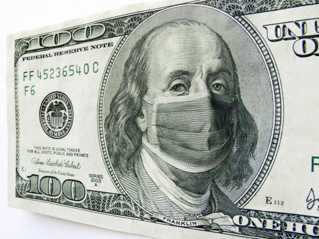 Ben Franklin Wearing A Coronavirus Healthcare Mask On One Hundred Dollar Bill.