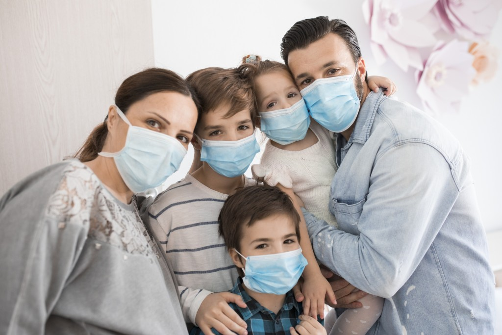 Portrait Of A Family At Home During A Corona Virus