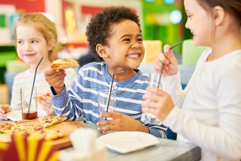 Happy Children In Pizzeria