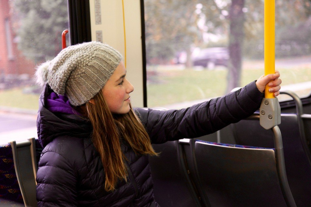 Young Teenage Girl Riding A Bus To School