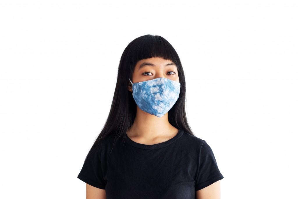 Teenage Girl Wearing Tie Dye Fabric Mask